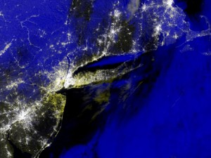 A composite image created from the VIIRS day-night band shows a portion of the Atlantic seaboard on November 1, 2012, just after Superstorm Sandy dissipated. The yellow regions indicate urban areas that had power before Sandy, but not after.
