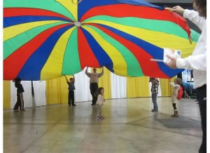 Children enjoy the popular parachute activity at WeatherFest.