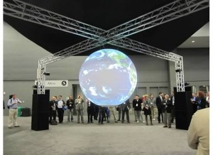 Attendees watch the weather of the world in the Exhibit Hall.